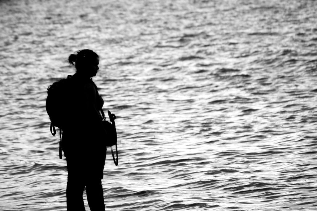 Leah Barclay recording Lake Cootharaba at Floating Land 2009. Photo by Adam Sebastian West.